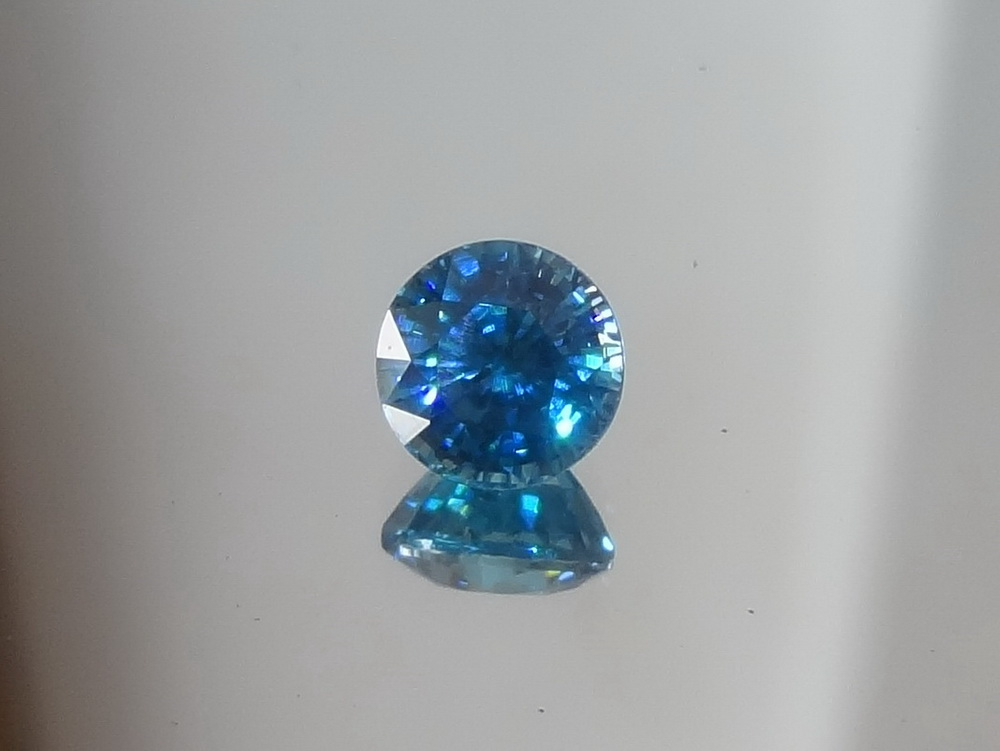 7mm Calibrated Round Swiss Blue Natural Zircon from Cambodia.