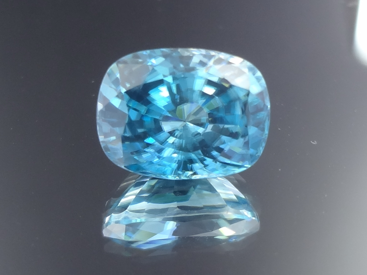 Blue Zircon cut in cushion, clean and very affordable.
