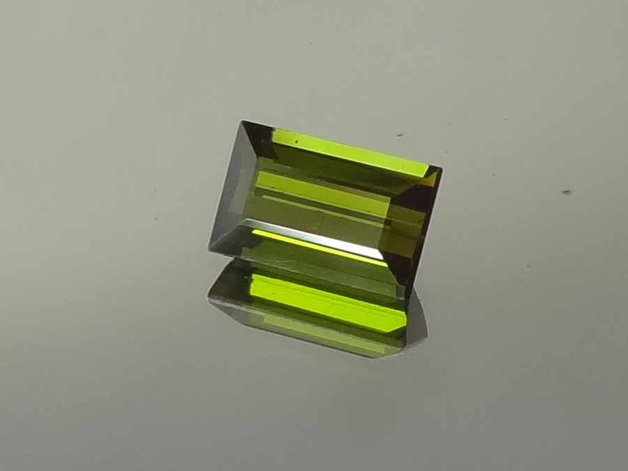 Olive green Tourmaline for sale faceted in rectangle.