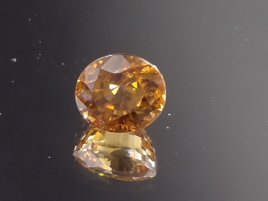 Natural very shiny oval orange Zircon from Cambodia.