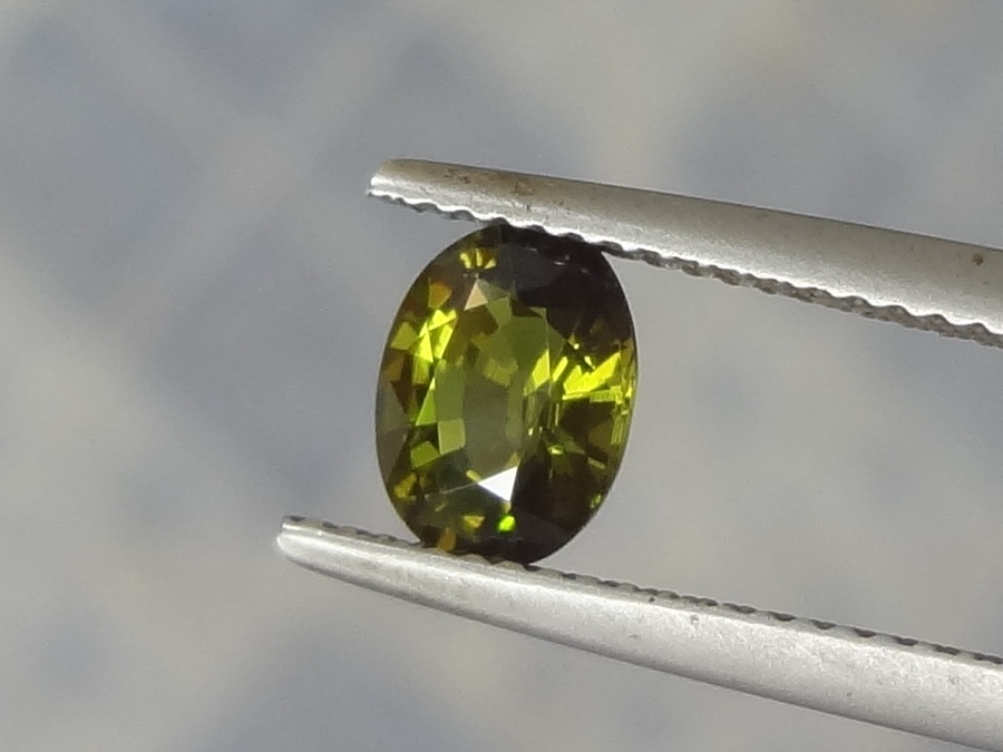 Olive green Tourmaline for sale faceted in oval.