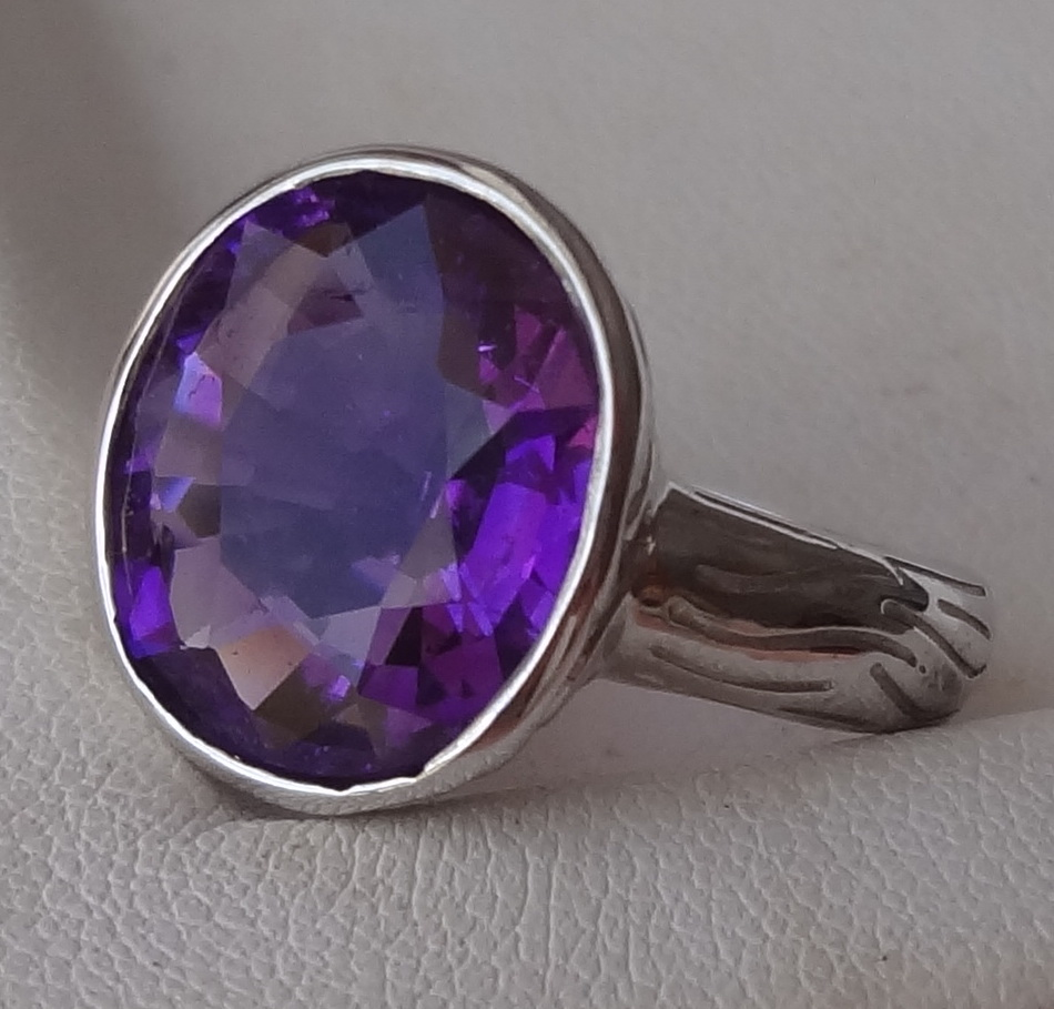 Cheap natural deep purple Amethyst and sterling silver ring.
