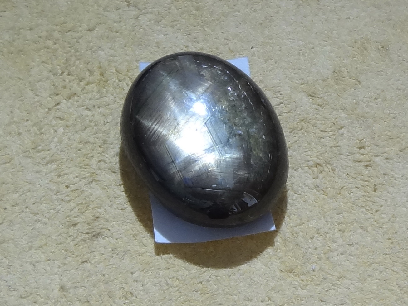 Black Star Sapphire in oval shape cabochon.