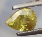 Drop cut yellow sphene gemstone.