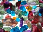 Potpourri of mixed colourful rough gemstones, purple, blue, yellow, green, orange, red and all colors.